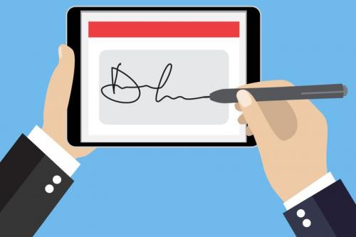 Hands signing an electronic signature on a tablet device